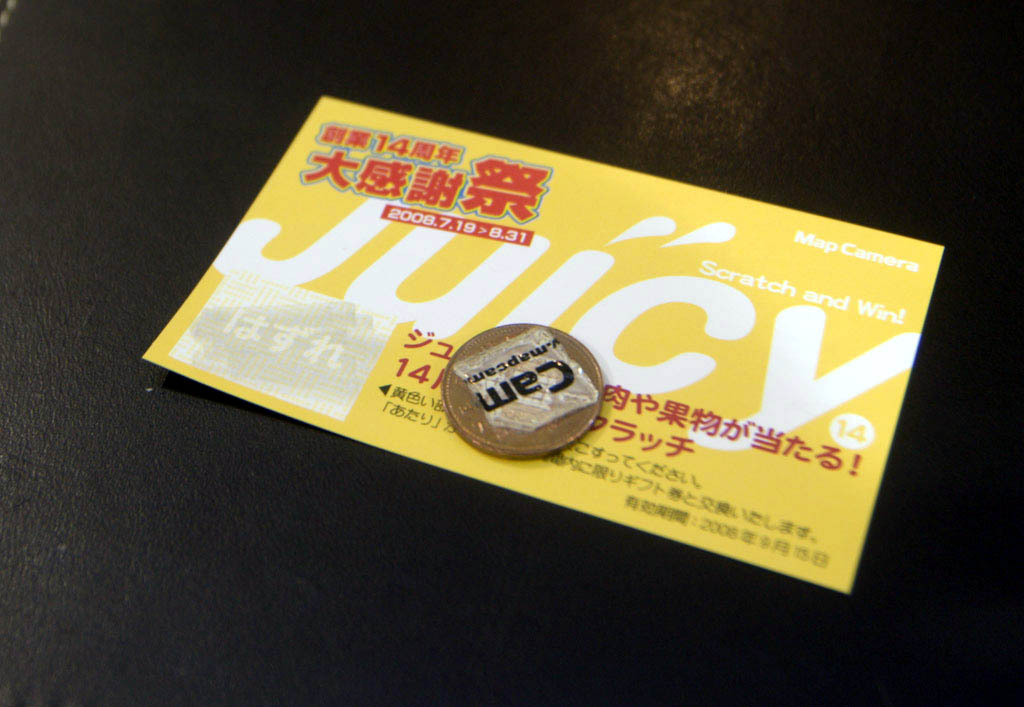 Tokyo: scratch card and coin with sticker