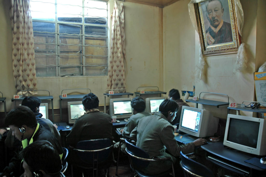 Lhasa: internet cafe, under the watchful eye