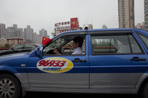 Shanghai: taxi and flag